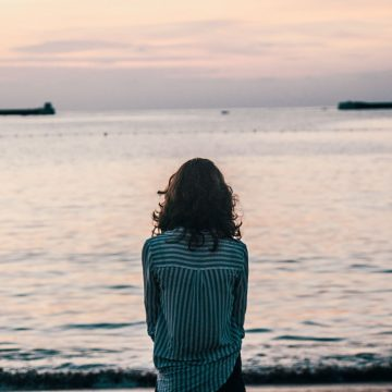 woman staring out at water