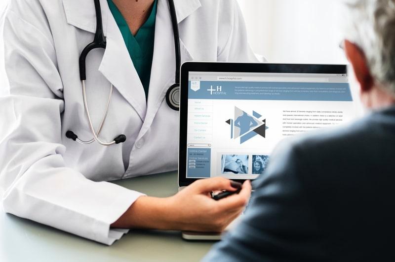 doctor showing patient computer screen